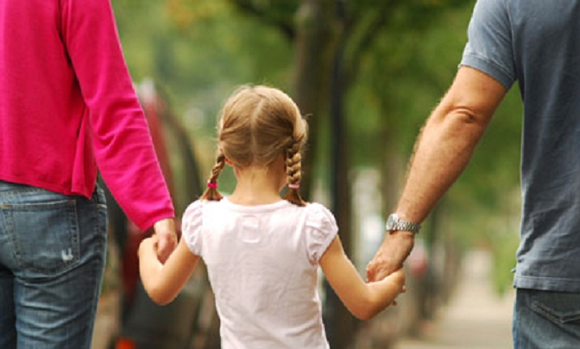 girl walking with parents