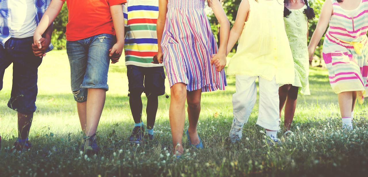 children walking hand in hand