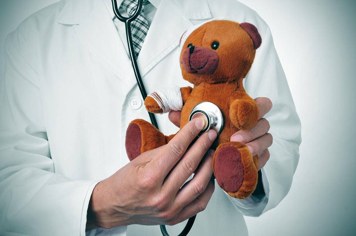 pediatrician examining teddy bear
