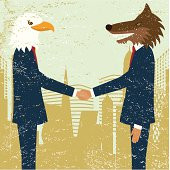 wolf and eagle in suits shaking hands
