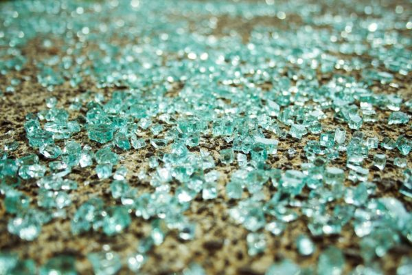 shattering glass reaction  the top of a water-filled glass bottle, causing the bottom to shatter,  these  violent reactions catastrophically crack the bottom of the bottle.
