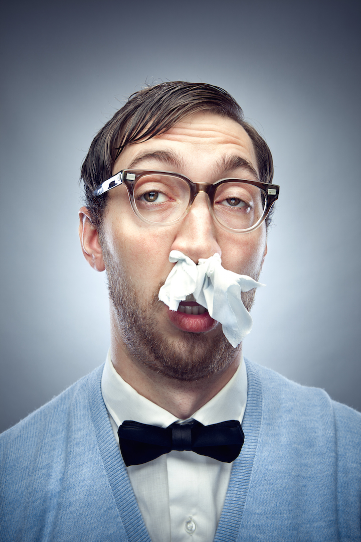 nerdy guy with tissues up his nose