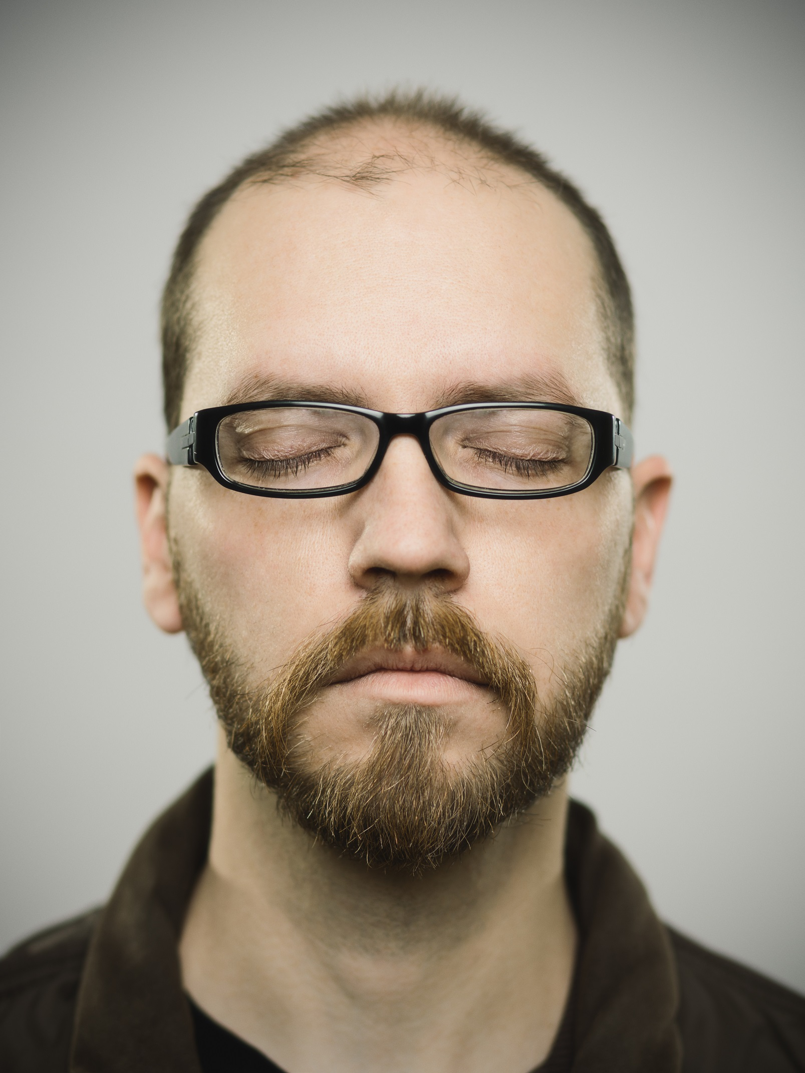 balding guy with glasses