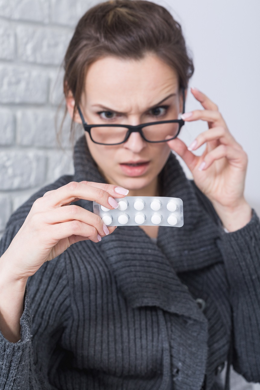 woman reading drug side effects