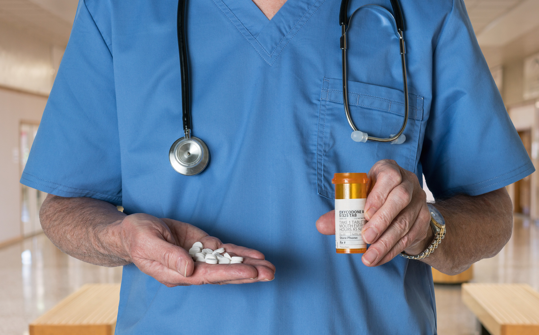 doctor holding pills