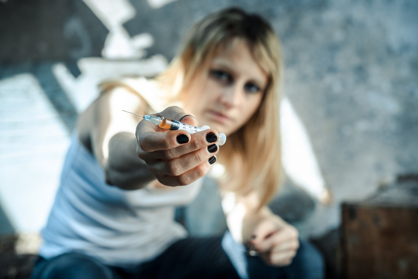 woman offering syringe