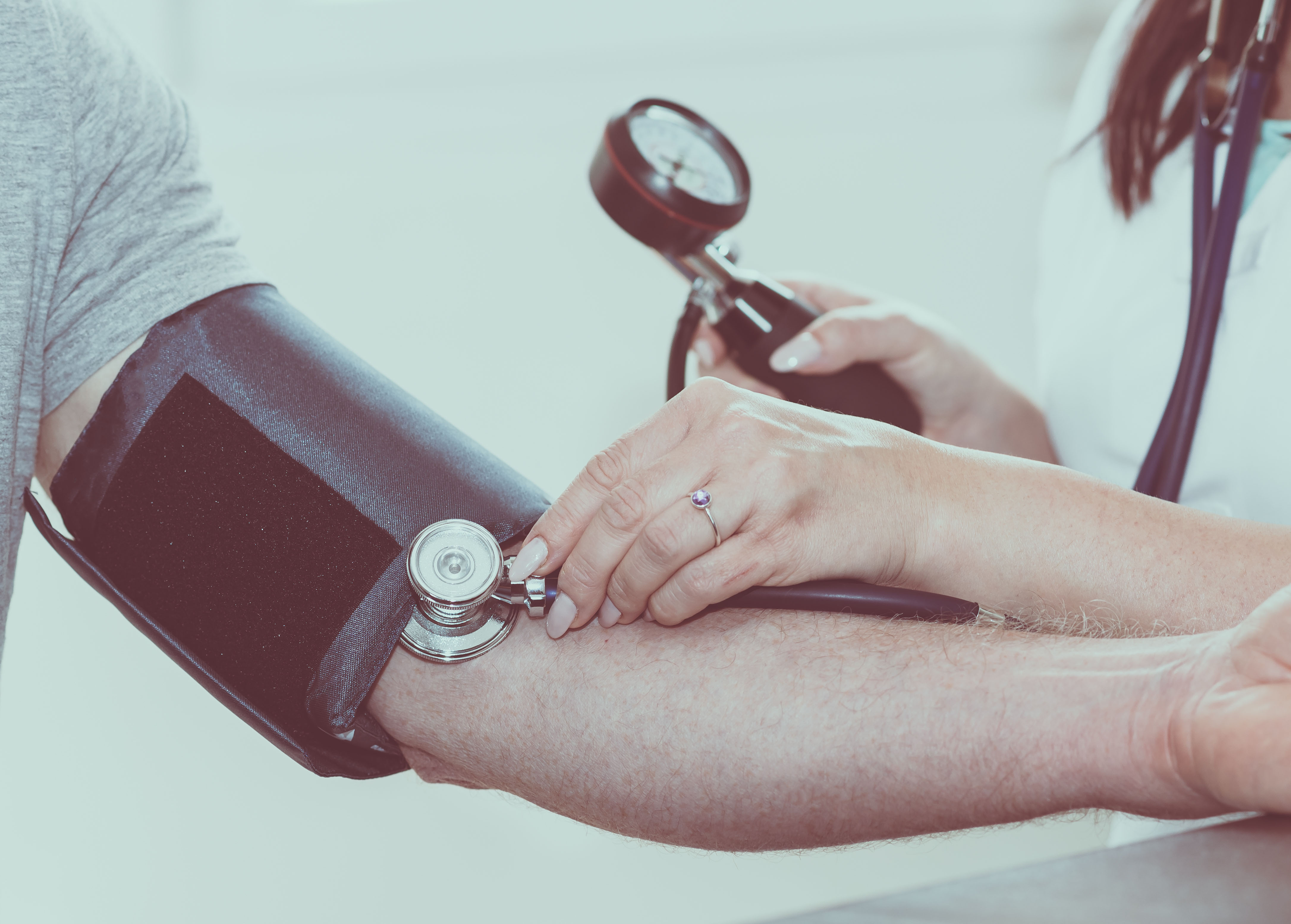 taking a person's blood pressure