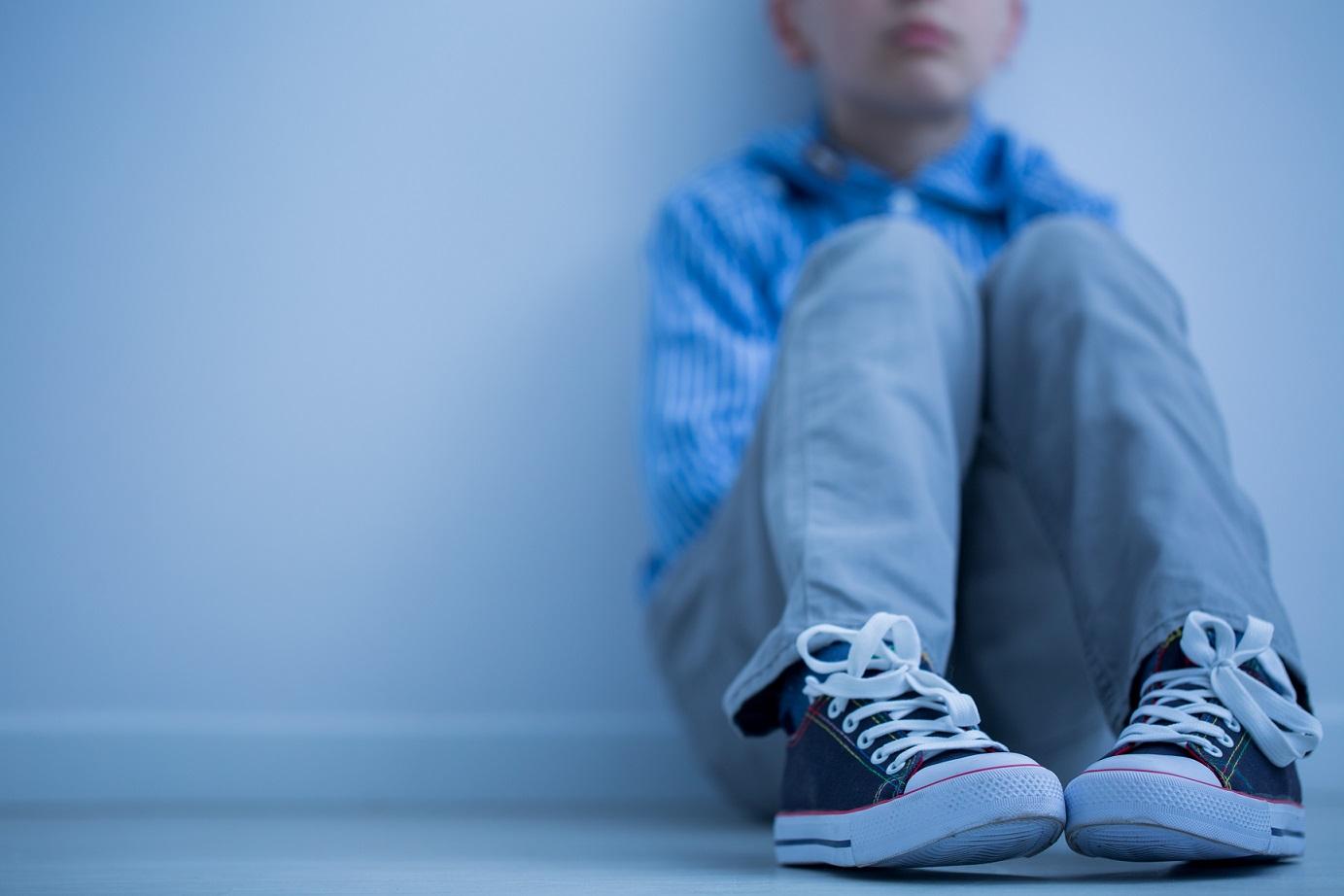 blue boy in sneakers